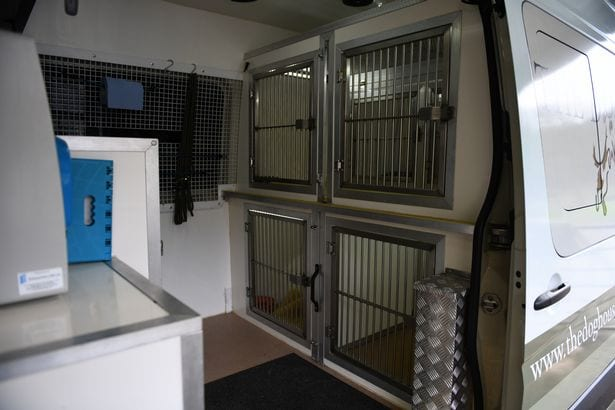 The specially designed van which takes dogs to and from the centre.